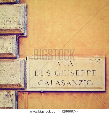 Street Sign on the Building in Roma Retro Effect