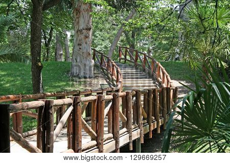 Wooden bridge in old park Buen Retiro of Madrid Spain