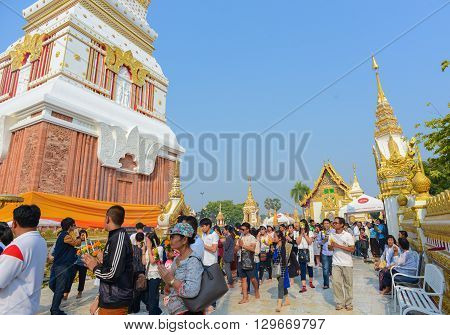 That Phanom Thailand - February 22 2016 : People walk around the Way That Phanom temple holding candles for prayers during Makha Bucha Day