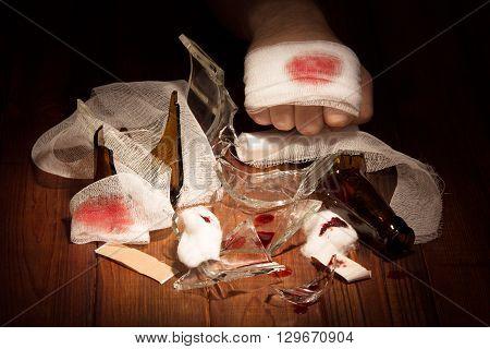 Injury hands behind broken bottle, bandages, cotton wool, adhesive tape
