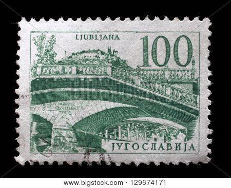 ZAGREB, CROATIA - JUNE 14: Postage stamp printed in Yugoslavia shows Triple bridge, Ljubljana, circa 1958, on June 14, 2014, Zagreb, Croatia