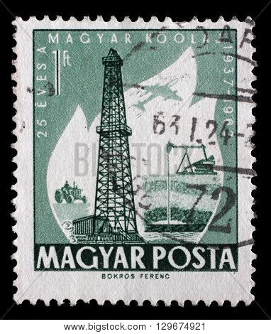 ZAGREB, CROATIA - JUNE 25: A stamp printed in Hungary dedicated to 25 anniversary of the exploitation of oil, shows Primitive and Modern Oilwells, circa 1962, on June 25, 2014, Zagreb, Croatia
