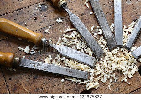 Many Sharp Steel Blades Many Chisels And Sawdust Chippings In Workbench