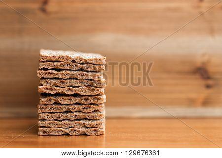 Closeup of crunchy crispbread on wooden table