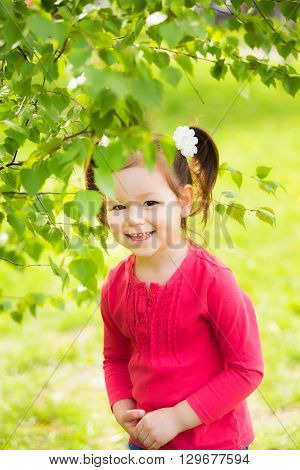 Child Playing Hide And Seek Outdoors In Park