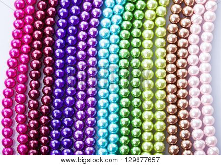 Different colors of beads necklace closeup background