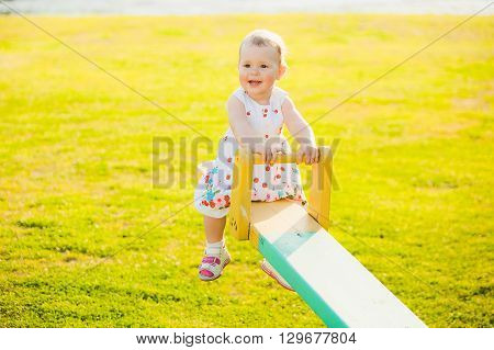 Little Girl Enjoying Riding Swing With Mum At Beautiful Nature Background