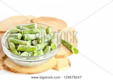 Frozen green beans in a glass bowl. Frozen food. Frozen vegetables