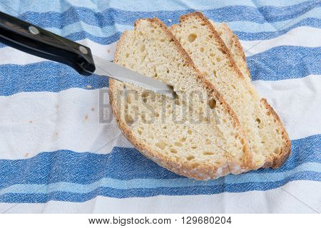 Piece and slices of unhealthy moldy bread and Knife