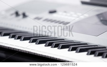 Electronic music instrument. Close-up photo. Shallow depth of field added for natural look
