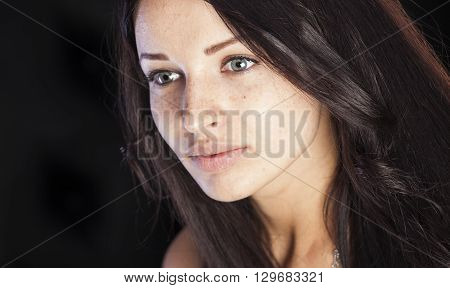 Natural beauty girl with freckles and pimples