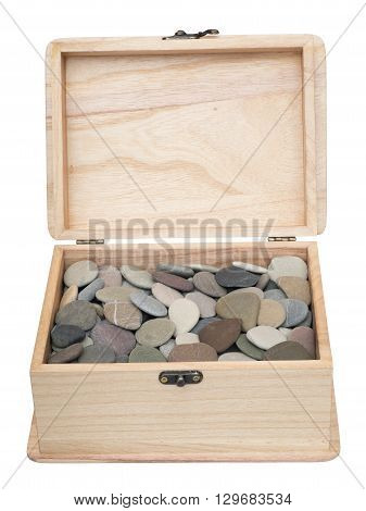 Open plain wooden casket with pebbles inside. Isolated on the white background. Front view.