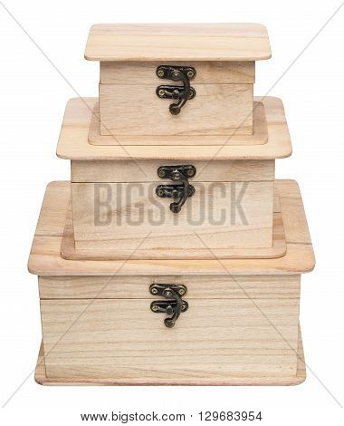 Pyramid from three closed plain wooden casket. Isolated on the white background. Front view.