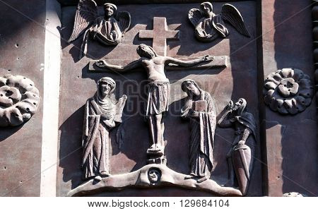 PISA, ITALY - JUNE 06, 2015: Crucifixion by Bonanno Pisano from the bronze doors of the Cathedral St. Mary of the Assumption in Pisa, Italy on June 06, 2015