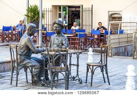 Toulon France - June 27 2009: Raimu square 'The card gamers' sculpture of Marcel Pagnol.