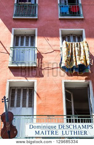 Toulon France - June 27 2009: The facade of a house of the old country center with the advertising of a cellos artisan.
