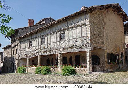 PEROUGES FRANCE - 29 APRIL 2015: Old framework houses at main square of medieval village Perouges in France