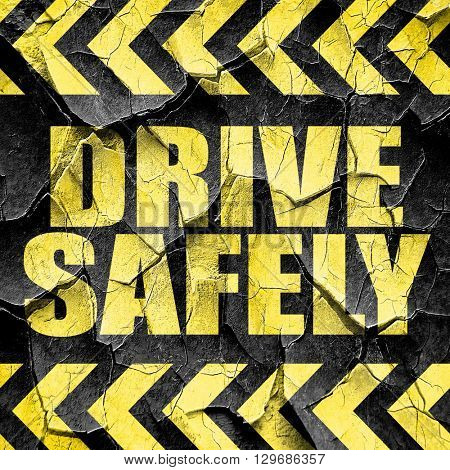 drive safely, black and yellow rough hazard stripes