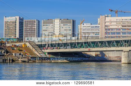 Basel, Switzerland - 31 October, 2014: the Rhine river and modern buildings. Basel is a city in northwestern Switzerland on the river Rhine, it is Switzerland's third most populous city after Zurich and Geneva.