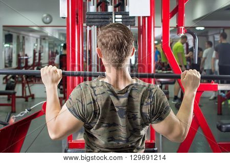 Man Performing Lat Pulldown At The Gym