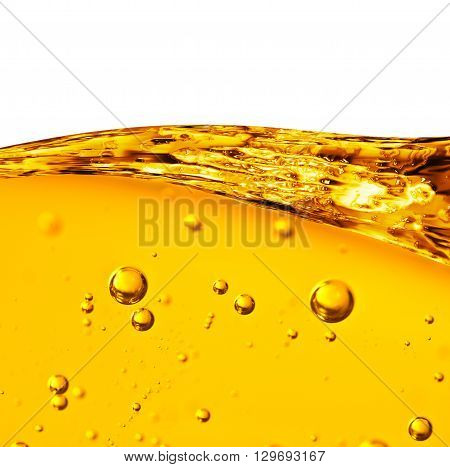 Oil background. Wave from yellow liquid with air bubbles on white background