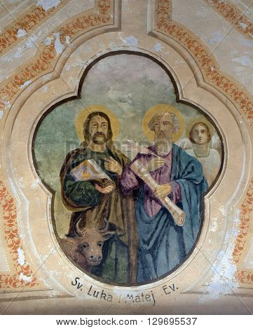 VUGROVEC, CROATIA - OCTOBER 02: Saint Luke and Saint Matthew the Evangelist, fresco in the Church of Saint Saint Michael in Vugrovec, Croatia on October 02, 2015