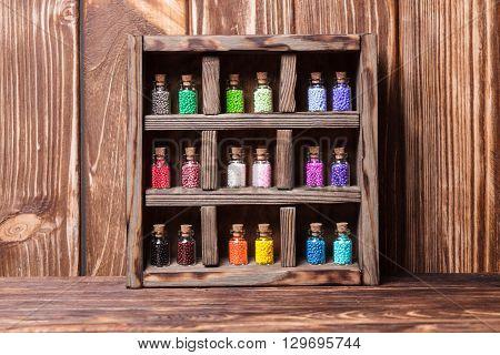 Beads in mini retro glass bottles, vintage box