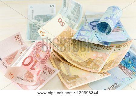 Euro Bills On Wooden Table