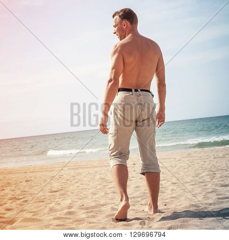 Barefoot Sporty Man Goes To The Sea
