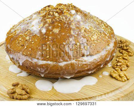 Cake with cream and walnut. Cake, walnut, cream on wooden board, isolated, white background
