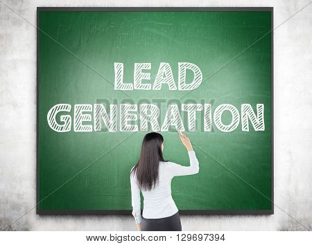 Lead generation concept with businesswoman writing on chalkboard