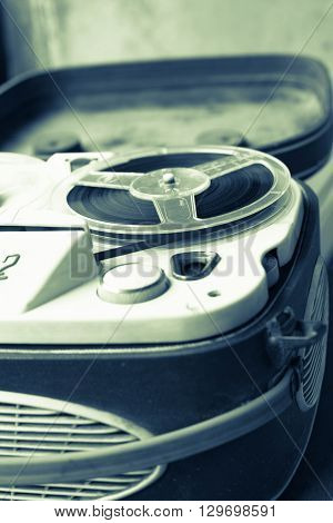 Old portable reel to reel tube tape-recorder. Portable reel tape recorder. Close up.