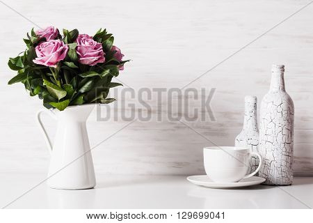 White still life with roses and cup