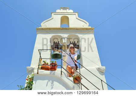 Girl Standing Beneath A Steeple