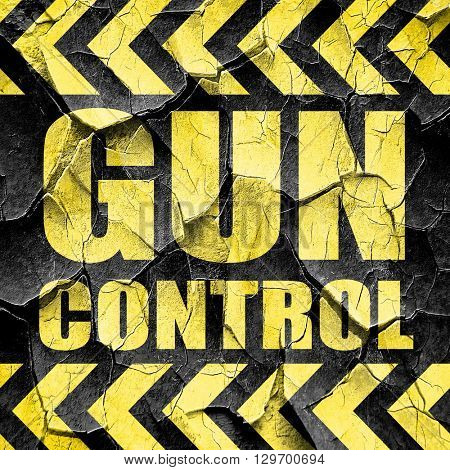 gun control, black and yellow rough hazard stripes