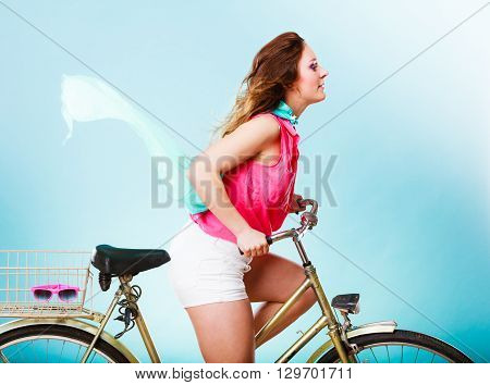 Active Woman Riding Bike Bicycle. Hair Windblown.