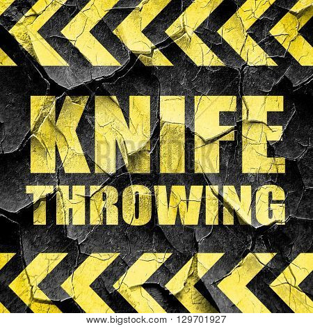 knife throwing, black and yellow rough hazard stripes