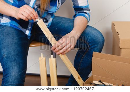 Woman Assembling Wood Furniture. Diy.