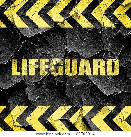 lifeguard, black and yellow rough hazard stripes