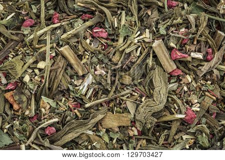 Closeup background of a Breathing and bronchitis herbal tea including ginkgo tea, lemon balm, lemon peel and green rooibos