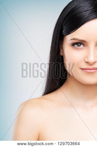Half-face portrait of beautiful caucasian woman, close up