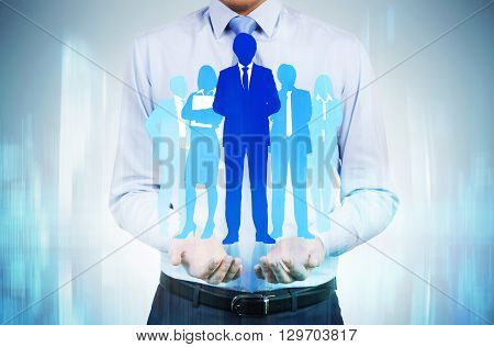 Human resources concept with man holding businesspeople silhouettes