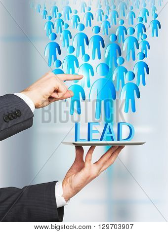Lead generation concept with businessman hands directing staff flow into tablet