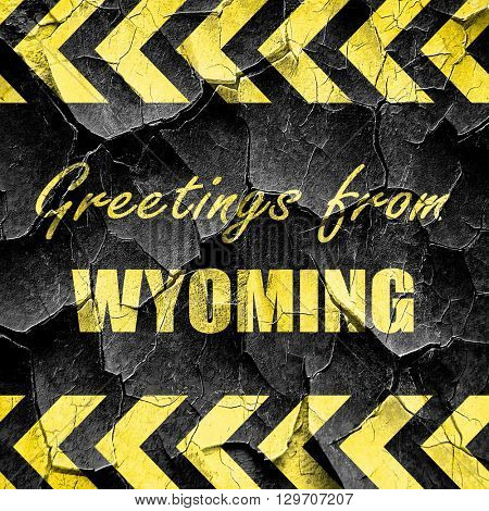 Greetings from wyoming, black and yellow rough hazard stripes