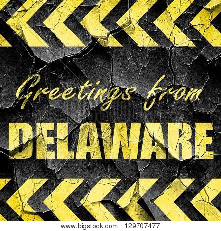 Greetings from delaware, black and yellow rough hazard stripes