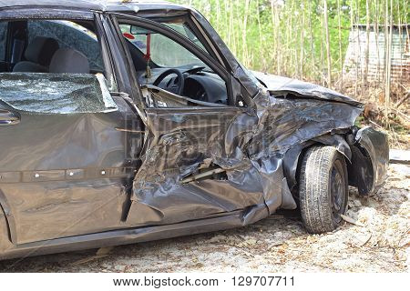 A wrecked car lays in wait after a vicious car accident.