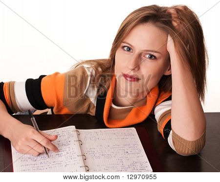 Young Tired Student On The Desk With Her Notes Dreaming