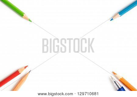 Colored pencils pen brown pencil at the corner of image - art equipment isolated on white background