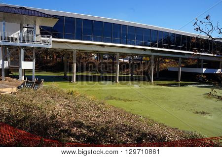 JOLIET, ILLINOIS / UNITED STATES - OCTOBER 25, 2015: The Center Bridge connects buildings across the JJC Lake at the Joliet Junior College.