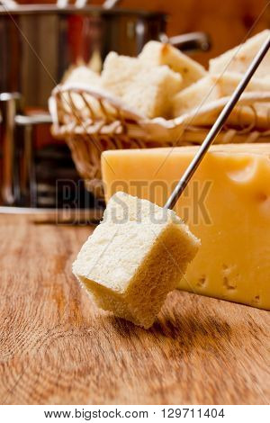 Crackers and Cheese Fondue on a wooden background